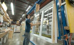 fitting glass into window frame