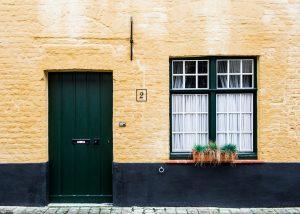 windows and dark green door