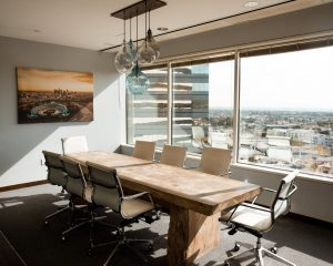 Sunlight streams through a set of energy efficient windows in an office board room.