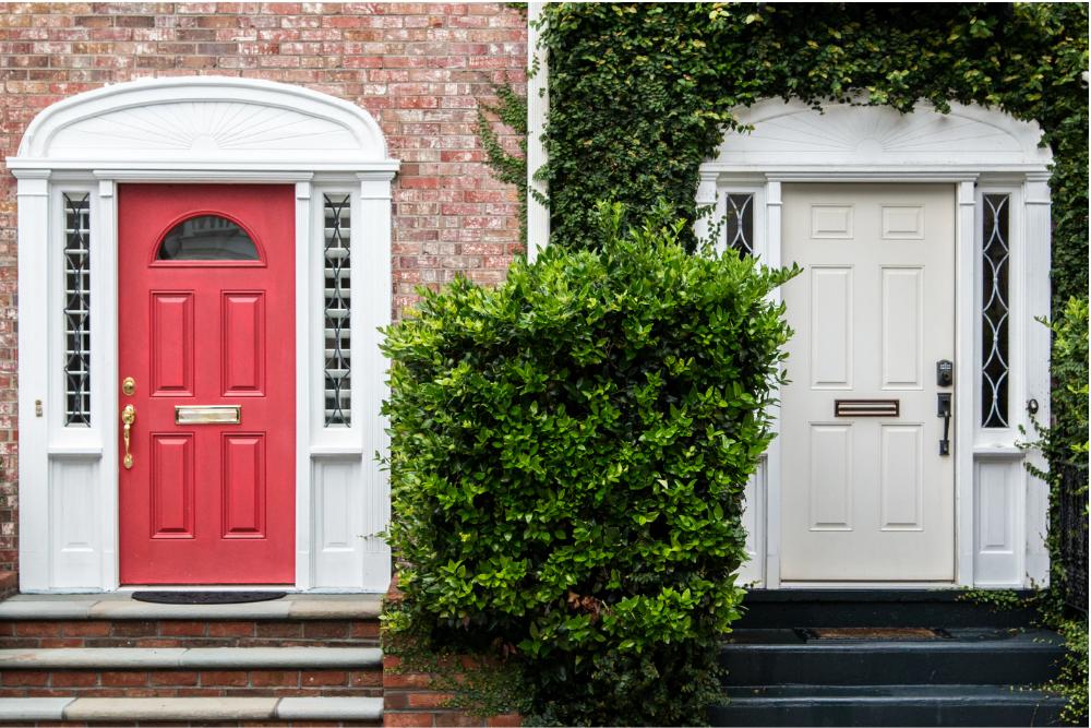 red fibreglass door vs white steel door comparison